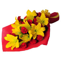 Rakhi with Flowers in India. Deliver 4 Orange Lily 12 Red Carnation Flower Bouquet to India on Rakhi