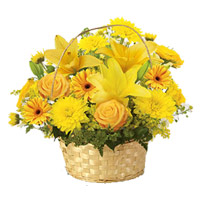 New Year Flowers Delivery to Kollam - Yellow Lily, Gerbera, Rose, Carnation Basket 12 Flowers to Kollam