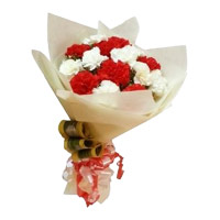 Send Rakhi with Red and White Carnation Bouquet 12 Flowers to Hyderabad