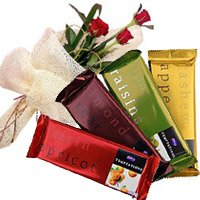 Diwali Flowers Delivery in India. 4 Cadbury Temptation Chocolates With 3 Red Roses. Diwali Gifts to India