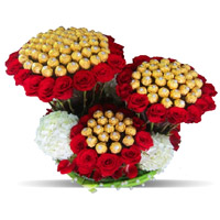 Online Diwali Chocolates Delivery to India. 96 Pcs Ferrero Rocher 200 Red White Roses Bouquet