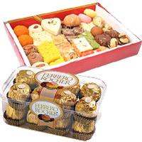 Send 1 Kg Assorted Mithai with 16 pcs Ferrero Rocher Chocolates. Rakhi Gift Delivery to India