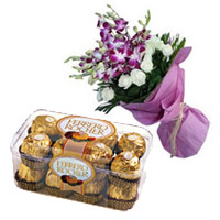 Order for Diwali Chocolates in India. Send 8 Orchids 12 White Rose Bouquet 16 Pcs Ferrero Rocher Chocolates to India