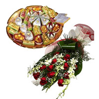 Deliver 6 White Orchids 12 Red Roses Bunch 1 Kg Assorted Kaju Sweets with Rakhi Gifts to India