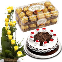 Deliver Cake in India - 15 Yellow Rose Basket 1/2 Kg Black Forest Cake 16 Pcs Ferrero Rocher to India