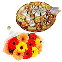 Order for 500 gm Assorted Kaju Sweets with 12 Mix Gerbera Flowers on Rakhi. Rakhi Flower Delivery in India