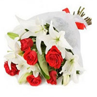 Online Rakhi Flower Delivery in India. 3 White Lily and 9 Red Roses Bouquet to India