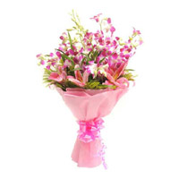 Send Rakhi with Pink Lily Purple Orchid Bouquet 12 Flowers in India Online