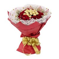 Send Valentine's Day Gifts to Vijayawada. 16 Pcs Ferrero Rocher Chocolate encircled with 20 Red Roses