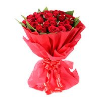 Deliver Flowers in Chandigarh. Red Rose Bouquet in Crepe 24 Flowers to India for Diwali
