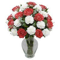 Send Flowers to Nanded and order for the best Red Rose White Carnation Vase 18 Flowers to Nanded