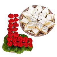 Send 24 Red Carnation Basket, 1/2 Kg Kaju Burfi Sweet and Rakhi to India