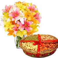 Deliver 10 Mix Lily Vase, 1 Kg Mix Dry Fruits with Rakhi gifts to India