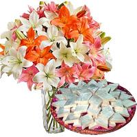 Order 18 Pink White Lily Vase and 1/2 Kg Kaju Katli Sweet to India. Online Rakhi Gifts and Flowers to India