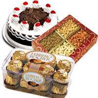 Rakhi Gift Delivery in India with 1/2 Kg Black Forest Cake with 1/2 Kg Dry Fruits and 16 pcs Ferrero Rochers Chocolates