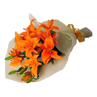 Rakhi Flowers to India. Orange Lily Bouquet 4 Flower Stems on Rakhi